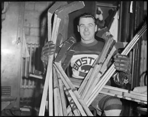 Pullman: Boston's oft-yanked goaltender Tiny Thompson takes stick stock, circa 1930. (Photo: Boston Public Library, Leslie Jones Collection)
