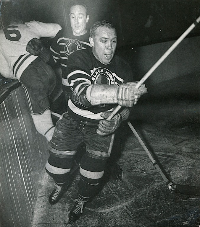 Stadium Welcome: Chicago defenceman Earl Seibert (rear) takes out Montreal's Toe Blake (6) while winger Mush March moves on in pursuit of pucks. The game, layer at Chicago's Stadium in January of 1944, ended in a 1-1 tie. Three months later, when the teams met in the Stanley Cup Finals, Canadiens prevailed, with emphasis, sweeping the Black Hawks four games to none.