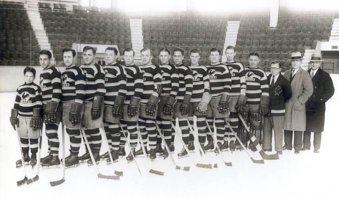 On The Rhode: Mickey Murray (fourth from the right) lines up with the 1929-30 edition of the Providence Reds. Teammates include Johnny Gagnon (second from left), Gizzy Hart (fifth), and Art Chapman (seventh from right). The coach is Sprague Cleghorn (light overcoat). (Credit: Rhode Island Reds Heritage Society, http://www.rireds.org)