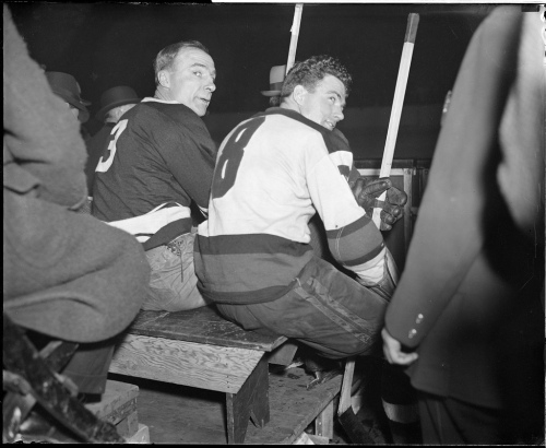 Hockey stars Lionel Conacher, left, and Roger Jenkins of the Bruins, on bench for being rough on the ice.