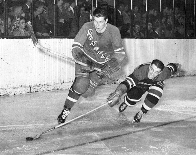 Low Poke: Chicago's Doug Bentley reaches for Pentti Lund's puck in a game at New York's Madison Square Garden in December of 1949.