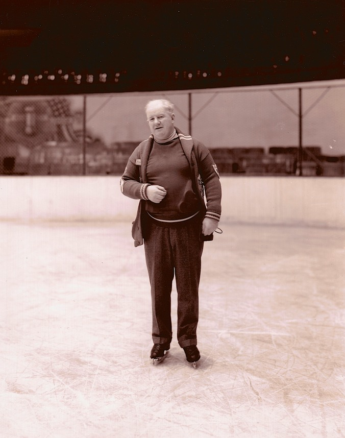 Everyone In Bed: Detroit coach and manager Jack Adams — with a shirt packed with pucks. (Photo: Albert E. Backlund)