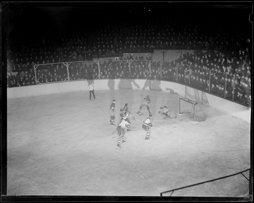 Shadowy men, in a shadowy Garden: Bruins host Maroons at Boston's Garden, circa the mid-1930s. (Courtesy of the Boston Public Library, Leslie Jones Collection)