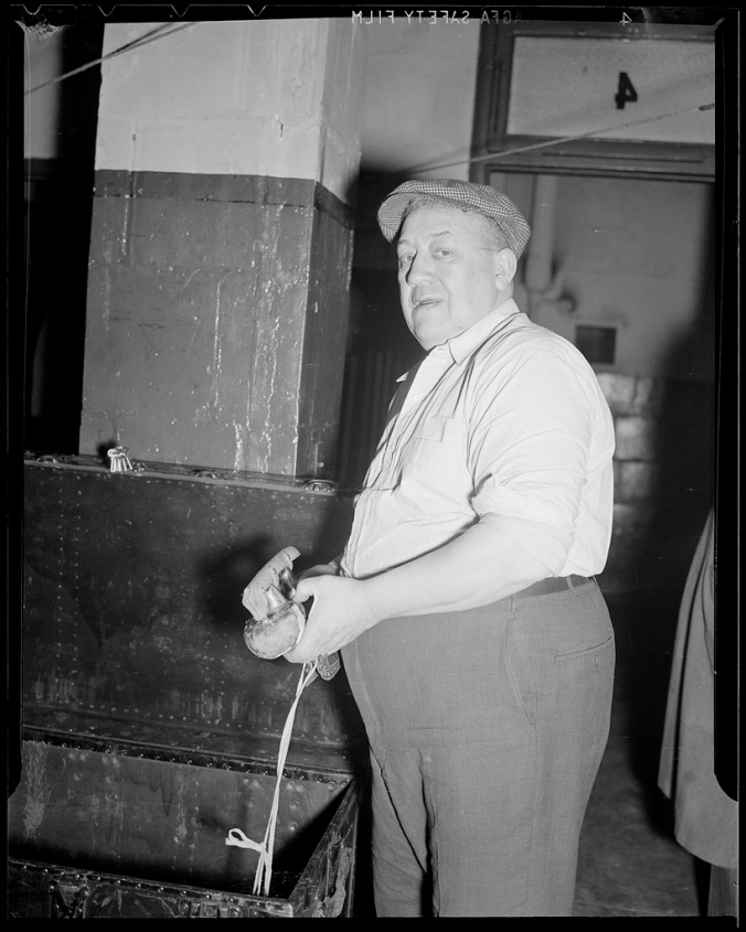 Master Of The Towels: Toronto Maple Leafs' trainer Tommy (a.k.a. Tim) Daly packs a skate in the Boston Garden circa 1936.  (Courtesy of the Boston Public Library, Leslie Jones Collection)