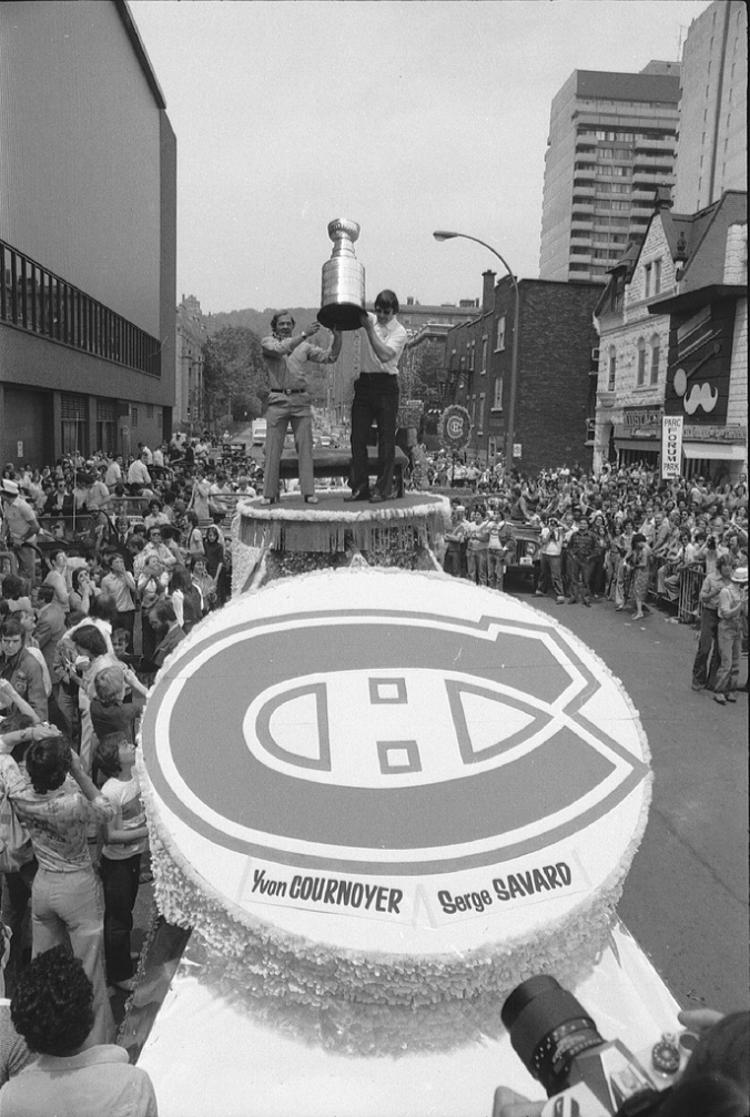 Halte la, halte la, halte la, les Canadiens, sont la. Les Canadiens, les Canadiens sont la! Happy anniversary, yesterday, to the Canadiens, founded in December of 1909 by a clutch of wealthy Irish-Canadians from Renfrew and Cobalt, Ontario. Flash forward, above, to the fruit of that labour: Yvan Cournoyer and Serge Savard parade the Stanley Cup outside the Forum on May 26, 1978. (Photo: Réjean Martel, Archives de la Ville de Montréal)