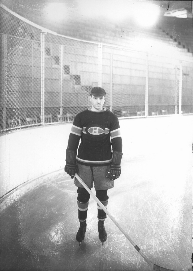 The Mighty Atom: Legendary Montreal left winger Aurèle Joliat poses at the Forum in the 1920s. As a teenager, he had a leg so lame from football that teams in Saskatoon and Regina gave him $100 for train fare home to Ottawa. A year later, the Canadiens acquired him, moving out the great Newsy Lalonde to make room. (Archives de la Ville de Montréal)