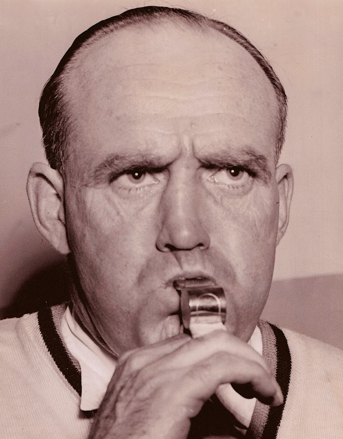 "Blow Hard: King Clancy with his whistle during his refereeing days, circa 1949. When he was starting in stripes, veteran referee Mickey Ion told him not to worry about the crowd or the players. ""Remember,"" Ion said, ""out of 15,000 people here, offficials are the only sane ones in the rink."""