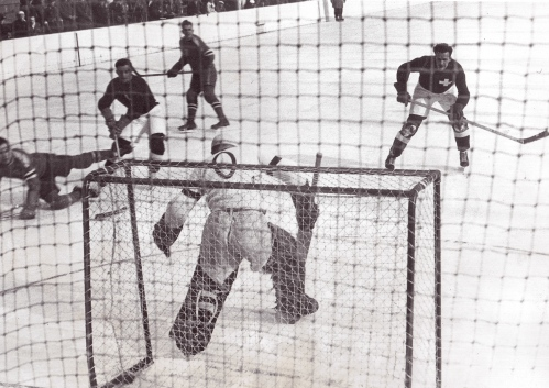 Swiss Misses: A U.S. foray at Switzerland's goal ends with a save at the Winter Olympics in Garmisch-Partenkirchen, Germany in February of 1936. The Americans won 3-0.
