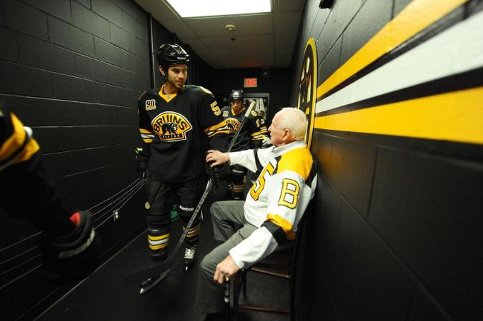 In October of 2013, Schmidt helped celebrate the Bruins' 90th anniversary before Boston's game with Detroit. Above, he greets Bruins' defence man Adam McQuaid. (Photo: @NHLBruins)