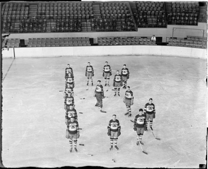 B-ing Boston: A slightly later edition of the Bruins, from 1930-31, arranges itself alphabetically on the ice of the old Boston Garden. That's Lionel Hitchman at the front, third from the left. Tiny Thompson is the goalie, and the Trojan, Eddie Shore, stands to his left. (Courtesy of the Boston Public Library, Leslie Jones Collection)