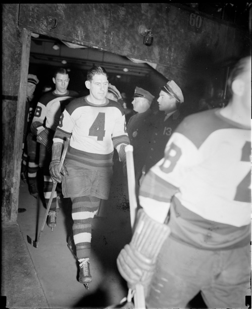 Strollers: Bruin defencemen make their way to the Garden ice in the spring of 1937. That's Allan Shields wearing number 4 with Eddie Shore in front of him and Dit Clapper trailing. (Photo courtesy of the Boston Public Library, Leslie Jones Collection)