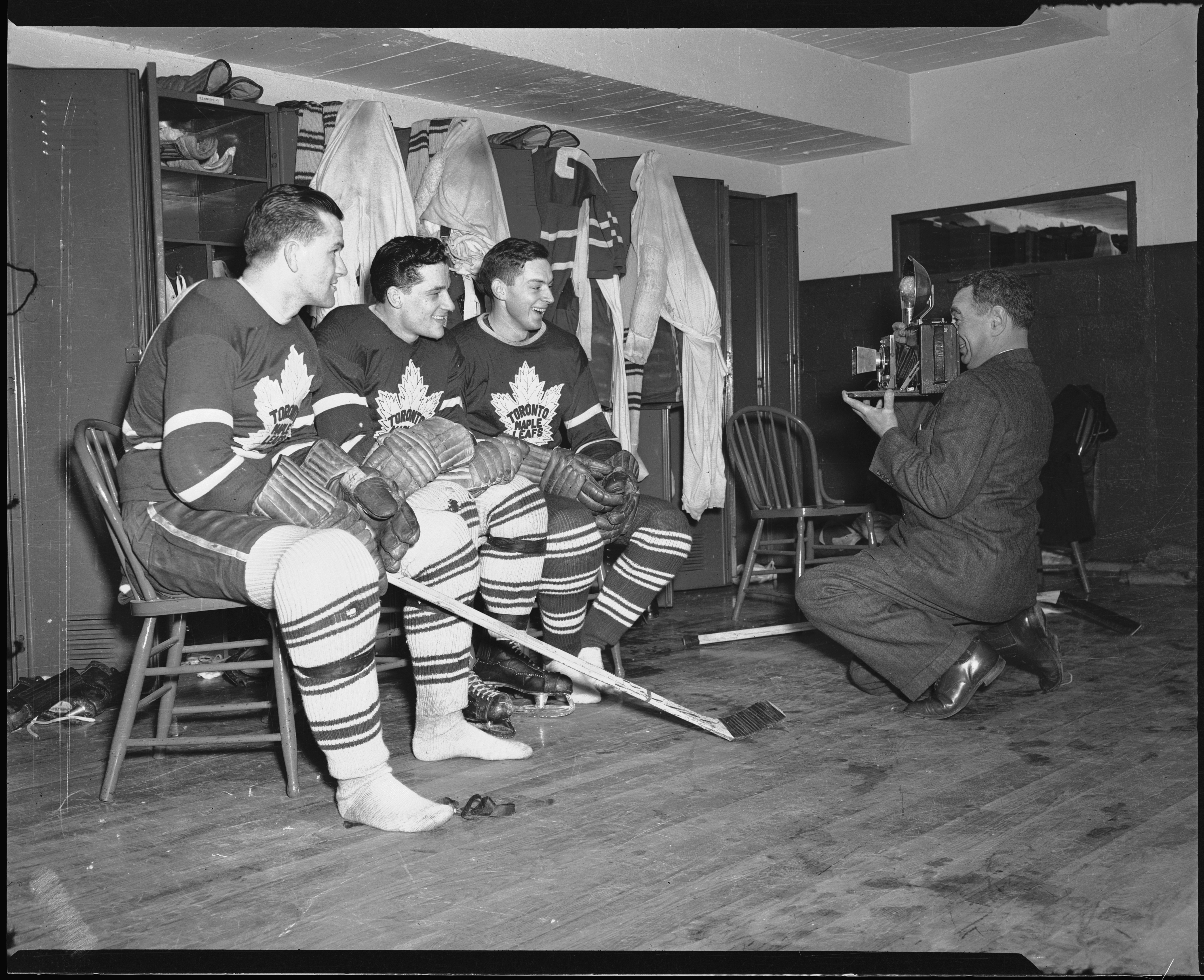 Still Leaf: Photographer Nat Turofsky lines up Leafs (left to right) Syl Apps, Bill Ezinicki, and John McCormack in the dressing room at Maple Leaf Gardens during the 1947-48 season. (Photo: Toronto Archives, fonds 1257, series 1057, item 9516, Alexandra Studio fonds)