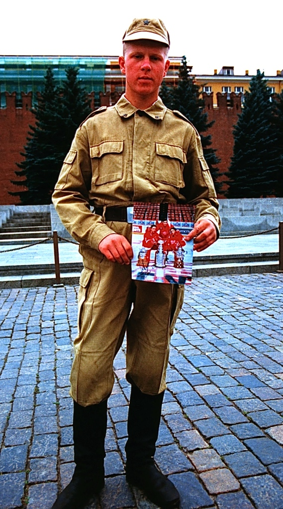 Wings Fan:  A Red Army recruit shows off a Detroit Red Wings glossy scored during a visit by Viacheslav Kozlov, Slava Fetisov, and Igor Larionov to Moscow's Red Square on August 18, 1997. (Photo: Stephen Smith)