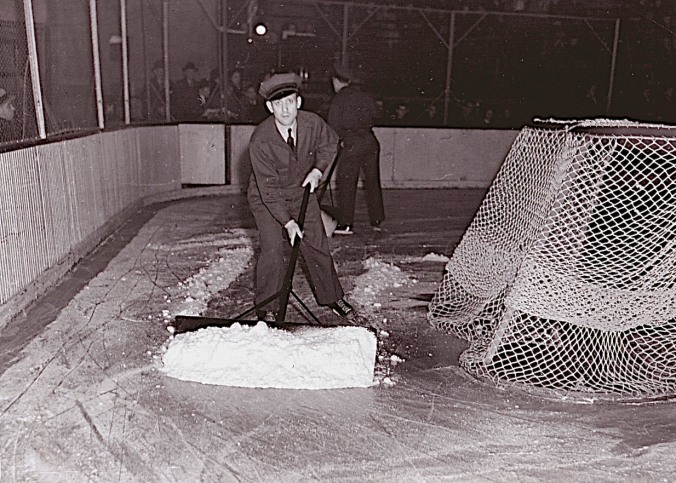 Snow Job: The men who skate and scrape, at Chicago's Stadium, circa 1941. A year later, in California, Frank Zamboni began to fiddle with tractors and sleds in his quest for a better way of resurfacing skating ice. It was 1949 before he got it right and 1954 by the time the first Zamboni flooded NHL ice, in Boston's Garden.