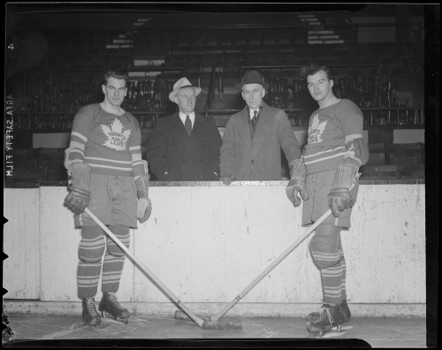 Four Leaf Posers: Two of Toronto's top-scoring forwards, Syl Apps and Gordie Drillon (left and right), bookend manager Conn Smythe and coach Dick Irvin. (Photo courtesy of the Boston Public Library, Leslie Jones Collection)
