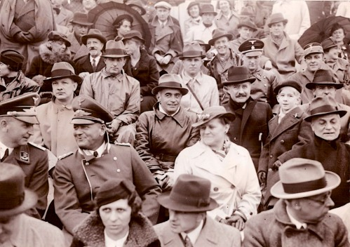 The good old Eishockey game: At a pre-war hockey game between Germany and France in Berlin in the fall of 1937, the attentive crowd includes (centre, in the leather coat and light hat) Hitler's Reichssportführer (Reich Sports Leader), Hans von Tschammer und Osten sitting beside (on his left) the French ambassador to Berlin, along with (second row from the front, second from left) Luftwaffe General Erhard Milch, who was at this time Hermann Göring's direct subordinate; and (next to him, conferring) Hans Frank, Hitler's personal lawyer who later became governor of Poland and (later still) was found guilty at trial at Nuremberg and executed for crimes against humanity. (Photo: Photoreportage Trampus)