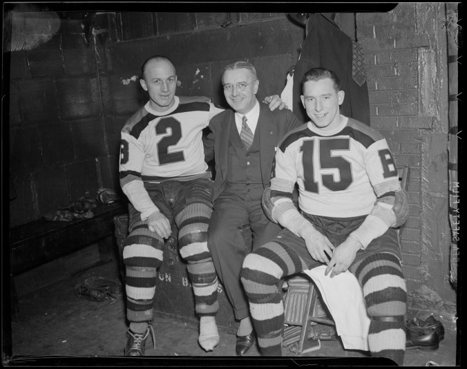 Eddie Shore, Dr. Martin Crotty and Milt Schmidt in Bruins locker room 1940ish