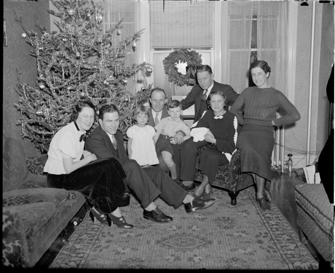 Merry + Bright: Bruins Myles Lane, Eddie Shore and Red Beattie pose by the tree with their families, circa 1932-1933. (Photo courtesy of the Boston Public Library, Leslie Jones Collection)