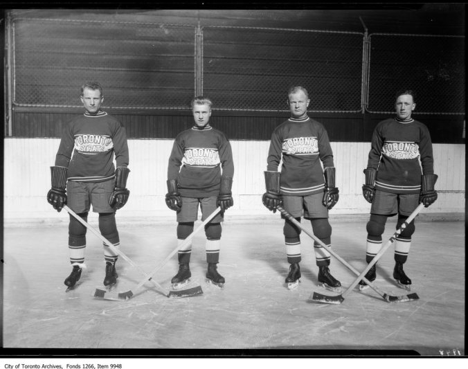 Irish Times: The Toronto St. Patricks weren't long for the world when four of them posed in early December of 1926. The following February, Conn Smythe and a parcel of investors bought the team and decided change was order. Just like that, in mid-season, green-and-brown St. Patricks turned to blue-and-white Maple Leafs. Above, looking sternly, left to right, are Hap Day, Al Pudas, Bert Corbeau, and Ace Bailey.