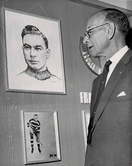 I and I: Frank Nighbor looks himself in the eye on a 1960s visit to the Hockey Hall of Fame display chronicling his distinguished career.  (Photo: Hockey Hall of Fame/ Library and Archives Canada/PA-048874)