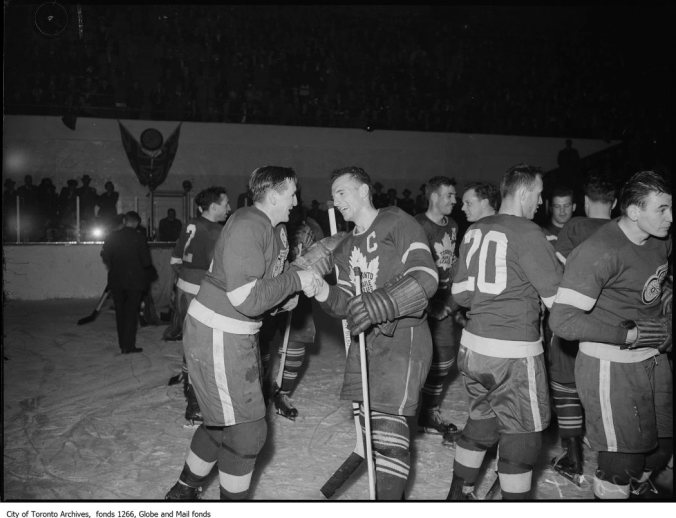 Aftershake: In April of 1949, the Toronto Maple Leafs swept to their third consecutive Stanley Cup, beating the Detroit Red Wings in four straight games. Above, captains Sid Abel and Ted Kennedy share a moment. A year later, after Gordie Howe was injured doing his best to check Kennedy, Abel was one of the Wings who went after the Leaf captain with malice aforethought. (Photo: City of Toronto Archives, Globe and Mail fonds, Fonds 1266, Item 132804)
