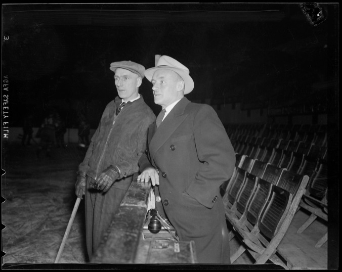 Conn and Coach: Smythe at Boston Garden at some point in the 1930s with Leafs' coach Dick Irvin, whose teams never missed the playoffs while he was in charge in Toronto. (Photo: Courtesy of the Boston Public Library, Leslie Jones Collection)