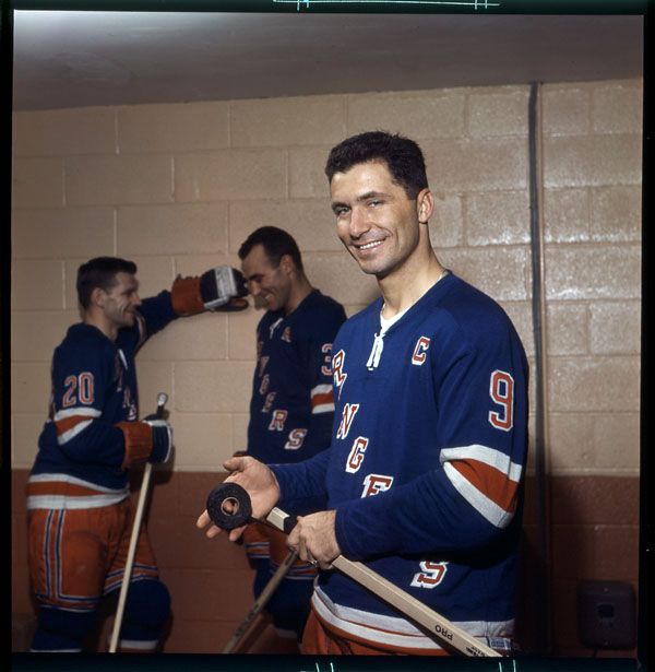 Captain Blueshirt: Andy Bathgate tapes up his Northland for a Weekend Magazine portfolio in 1963. In back that assistant captain Harry Howell and, on the left, Phil Goyette. (Photo: Louis Jaques / Library and Archives Canada / e002505689)
