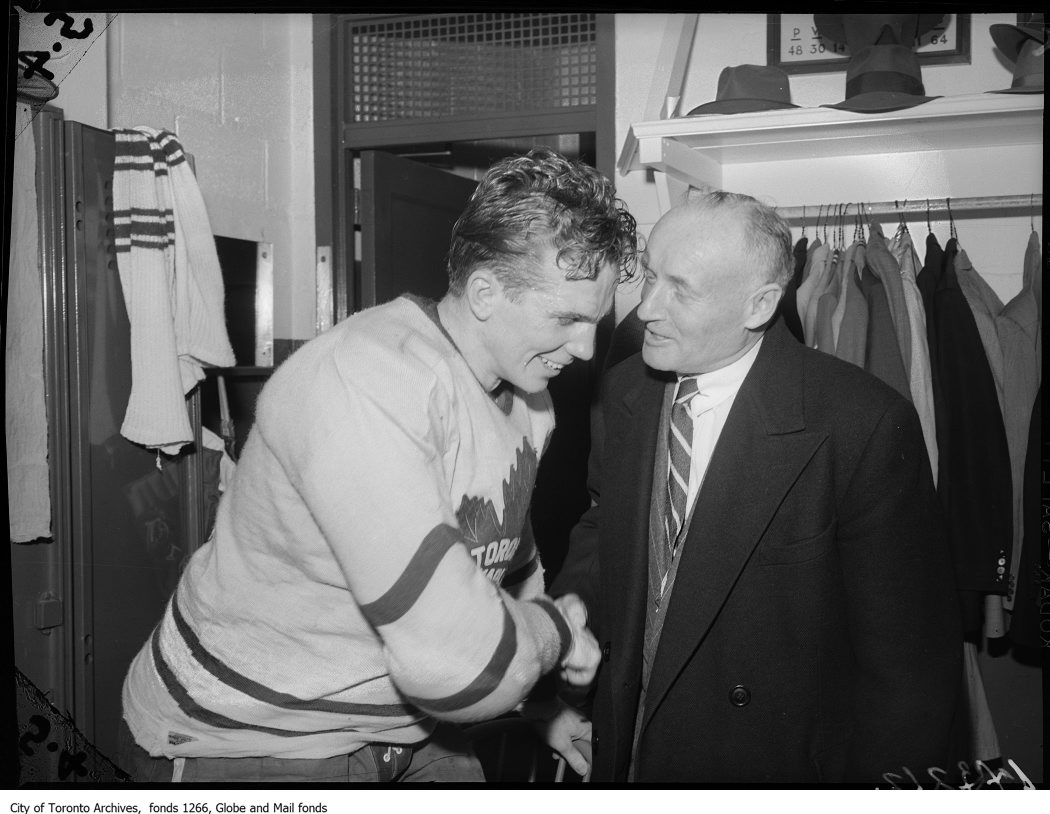 """Pro and Conn: Leaf boss Smythe congratulates Bill Barilko after his overtime goal won Toronto a Stanley Cup. """"We just out-Irished them,"""" Smythe said at the time, alluding to Leaf luck in a tight series."""