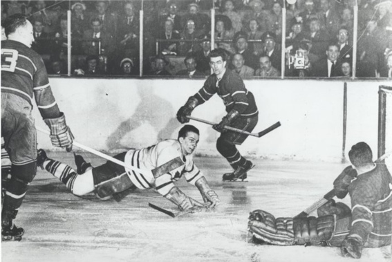 Won The Leafs The Cup? Barilko looks to see if he's scored in this view by Globe and Mail photographer Michael Burns.