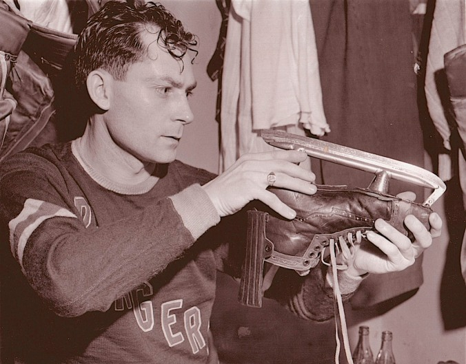 Sharp-Eyed: New York Rangers' right winger Bryan Hextall checks his blade in 1942, the year he led the NHL in scoring.