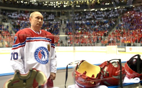 Goalscorer-in-Chief: Russian President Vladimir Putin readies himself for the task ahead yesterday at  Sochi's Bolshoi Ice Palace.