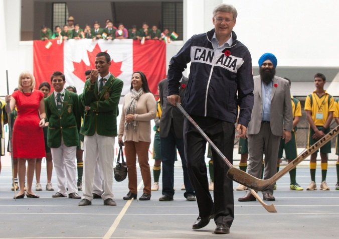 Forechecker-In-Chief: Prime Minister Stephen Harper takes up a stick during a visit to the Bishop Cotton Boys School in Bangalore, India, in November of 2012. (Photo: PMO/ Jason Ransom)