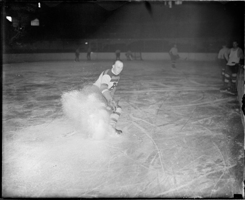 Snow Show: Eddie Shore flurries to a stop at Bruins practice, circa the 1930s. (Photo: Courtesy of the Boston Public Library, Leslie Jones Collection.)