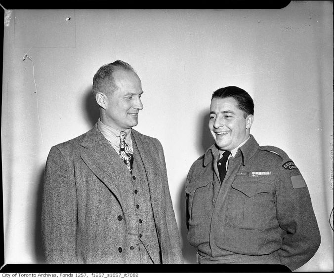 At Ease: Maple Leafs coach Hap Day chats with Private Smith.