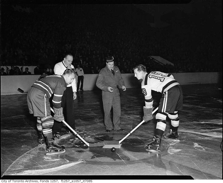 Private Practice: Smokey Smith tosses the inaugural puck of the 1945-46 NHL season for