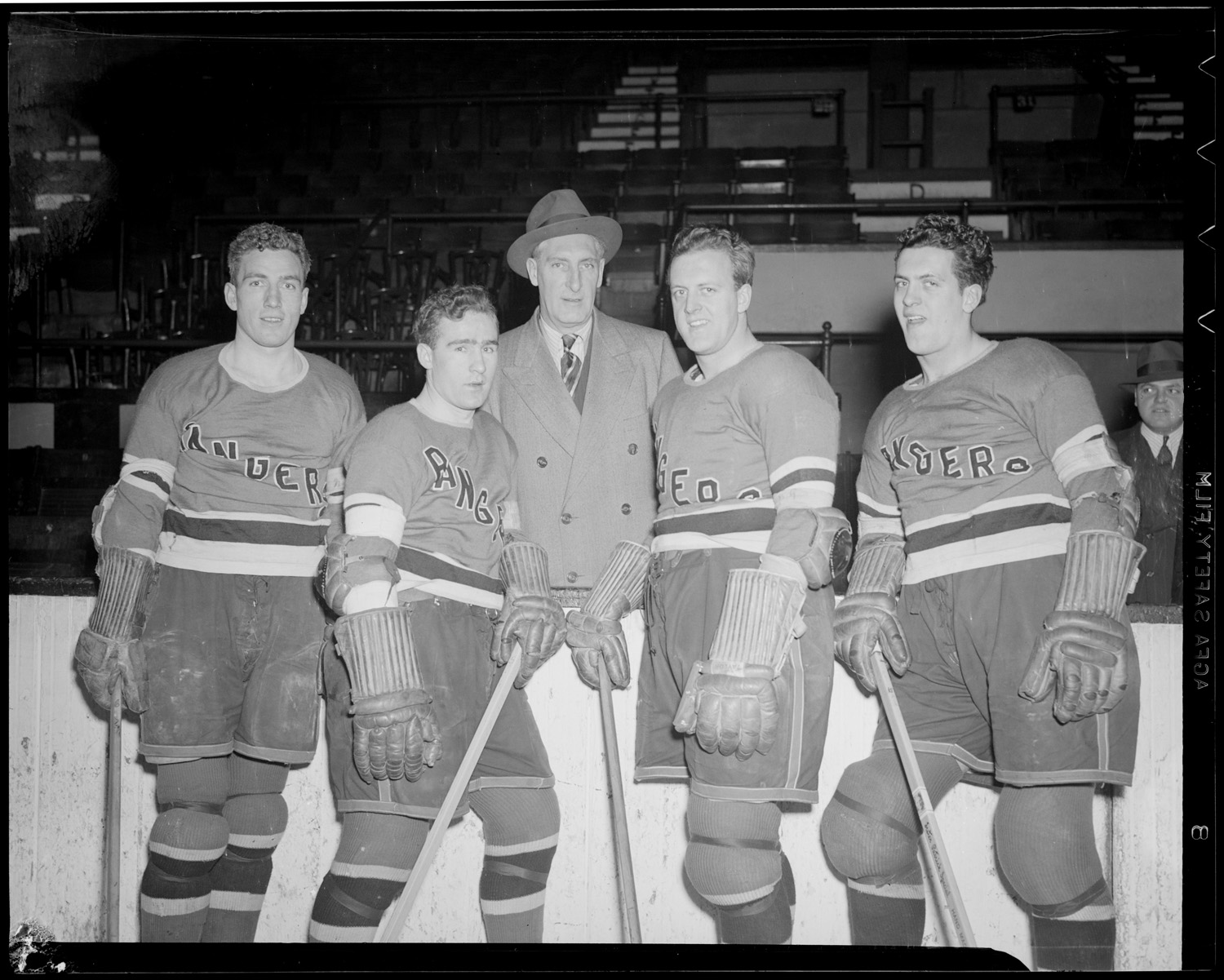 Families Firm: New York Rangers GM Lester Patrick pauses in Boston circa 1939 with his sons, on his left, Lynn and Muzz Patrick. To his right are brother Neil and Mac Colville. (Photo: Courtesy of the Boston Public Library, Leslie Jones Collection)