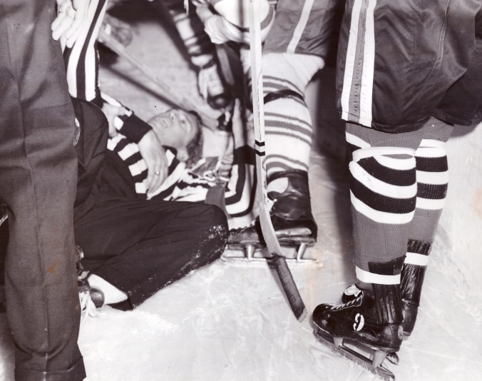 "Ed Powers Hawks-Leafs, slammed into baorad, ""After three minutes of rest, Powers was able to continue."" Nov 11 1959"